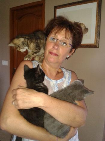 Dany Clauw avec 3 de ses bébés adoptés le même jour, sortis de la rue...